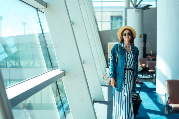 Woman go travel with suit case at airport - Stock Photo - Images