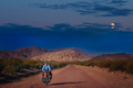 Woman cycling at night