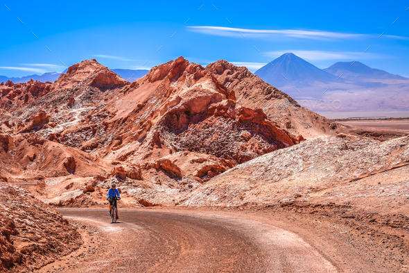 Cycling through the famous Valle the la Luna  in Chile - Stock Photo - Images
