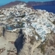 Santorini Aerial View Video of Greek Island with White Houses and Blue Roofs on Sunset and in the - VideoHive Item for Sale