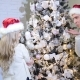 Young Beautiful Couple Dresses Up a Christmas Tree - VideoHive Item for Sale