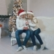 Happy Young Couple in Christmas Caps Drinking Tea From Mugs and Laughing - VideoHive Item for Sale