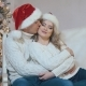 Young Loving Couple Embracing a Beautiful Girl Sitting Near a Christmas Tree - VideoHive Item for Sale