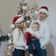 Happy Young Family Standing Near a Decorated Christmas Tree and Smiling - VideoHive Item for Sale