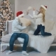 Young Guy and Girl Cheerfully Fight Cushions Near the Christmas Tree - VideoHive Item for Sale
