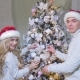 A Loving Beautiful Couple Dresses Up a Christmas Tree - VideoHive Item for Sale