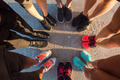 Runners standing in a huddle with their feet together - PhotoDune Item for Sale