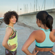 Two young smiling fitness women talking - PhotoDune Item for Sale