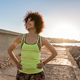 Smiling young sportswoman warming up before jogging outdoors - PhotoDune Item for Sale