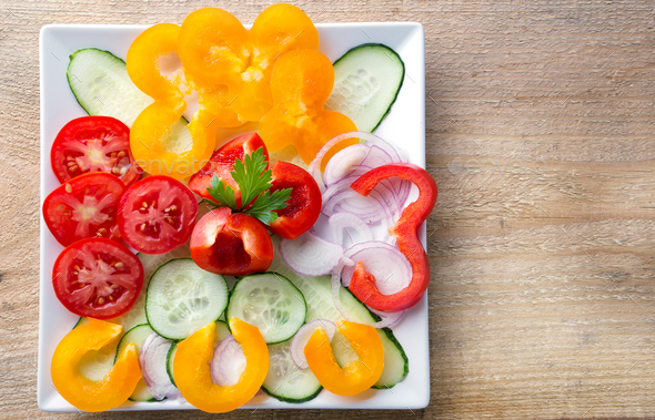 Fresh sliced vegetable salad on a white plate - Stock Photo - Images