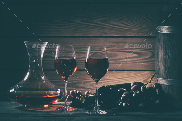 Wine still life with red wine in glasses and grapes - Stock Photo - Images