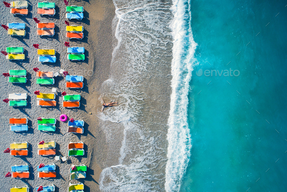 Aerial view of lying woman on the beach - Stock Photo - Images