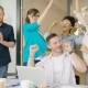Coworkers Celebrating Victory in Office