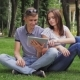 A Girl And a Guy Use a Digital Tablet - VideoHive Item for Sale