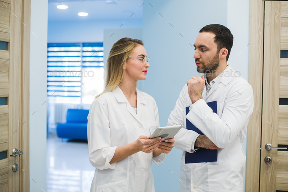 Medical Staff Having Discussion In Modern Hospital Corridor - Stock Photo - Images