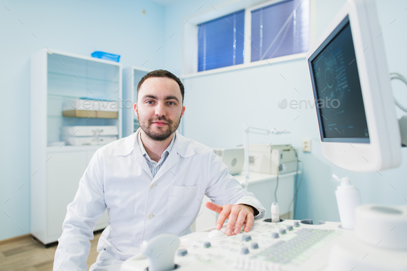 Male doctor with ultrasonic equipment during ultrasound medical examination - Stock Photo - Images