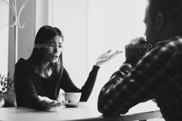 Young couple arguing in a cafe. Relationship problems. - Stock Photo - Images