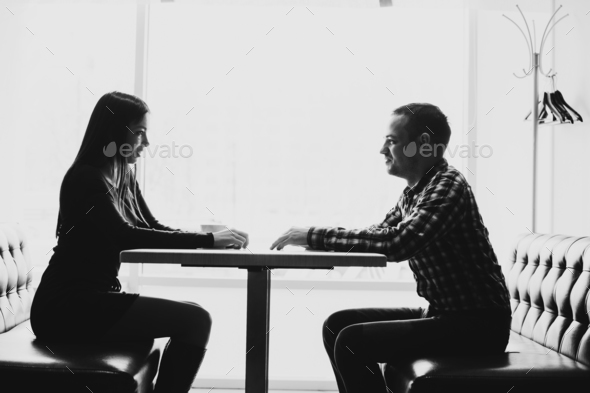 Man and woman in discussions in the restaurant - Stock Photo - Images