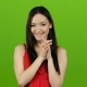 Girl in a Red Dress Flirts, Sends Kisses and Smiles. Green Screen - VideoHive Item for Sale