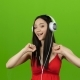 Girl Listens To Cheerful Music Through Headphones and Dances. Green Screen - VideoHive Item for Sale