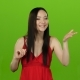Girl Sends Air Kisses, Smiles and Waves To Everyone Around. Green Screen - VideoHive Item for Sale