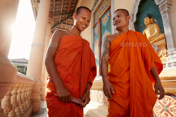 Two Monks Meet and Salute in a Buddhist Monastery Asia