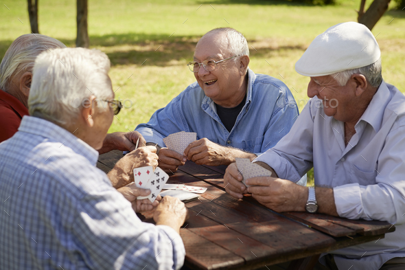 Active Seniors Group Of Old Friends Playing Cards At Park - Stock Photo - Images
