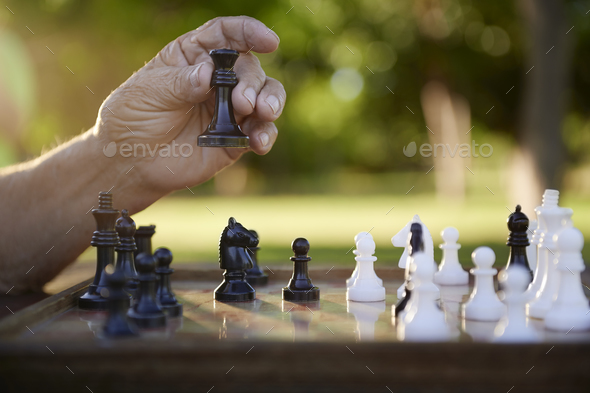Active Retired People Senior Man Playing Chess At Park