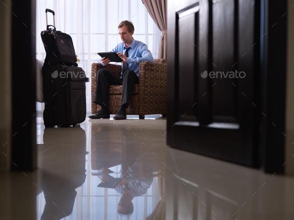 Businessman Using Digital Tablet Pc In Hotel Room