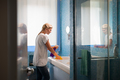 Young Woman Doing Chores And Cleaning Bathroom At Home - PhotoDune Item for Sale