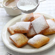 new orleans beignet, sprinkle powdered sugar with sieve - PhotoDune Item for Sale