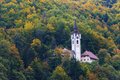 A church in a fall forest in Slovenia - PhotoDune Item for Sale