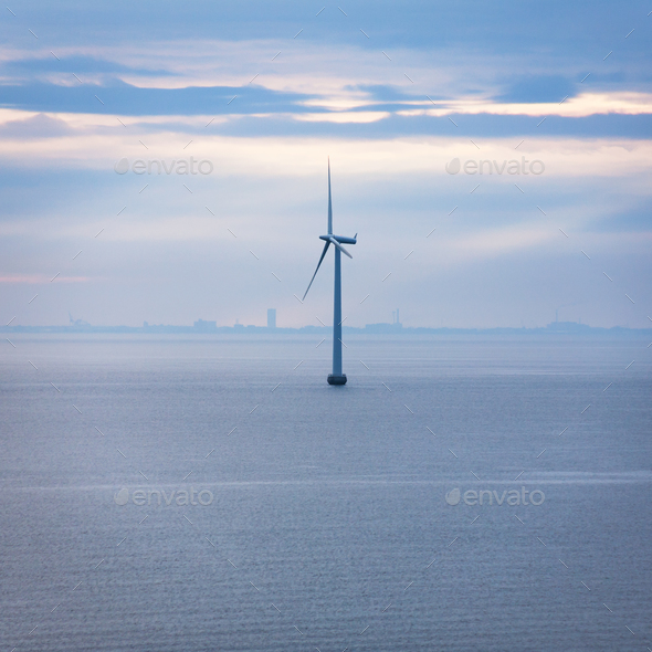 one turbine of offshore wind farm in morning