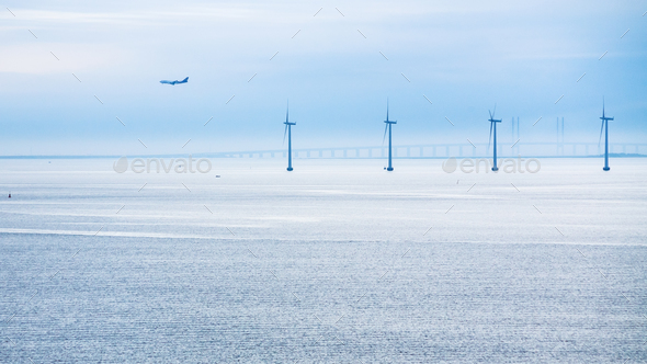 airplane, bridge and offshore wind farm in morning