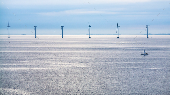 calm surface of Baltic Sea with offshore wind farm