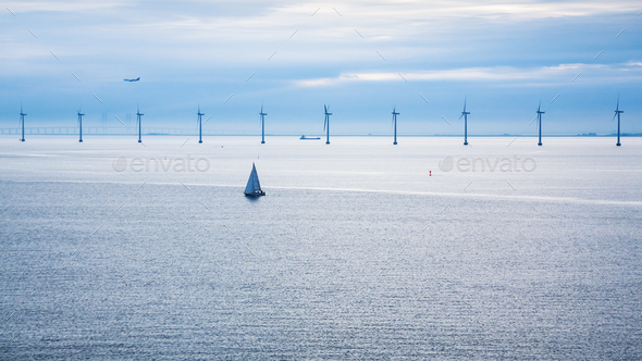 airplane and ships near offshore wind farm