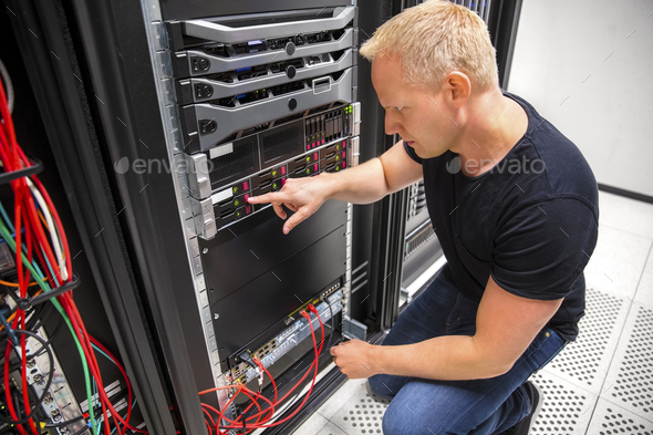 IT Technician Monitors Server On Rack In Datacenter - Stock Photo - Images