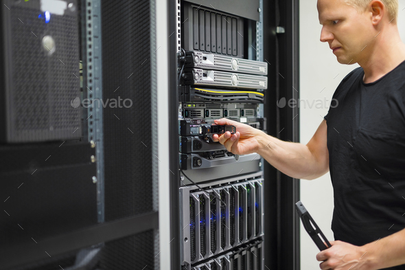 IT Engineer Installing Hard Drive In Rack Server - Stock Photo - Images