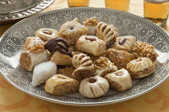 Traditional festive Moroccan cookies and tea - Stock Photo - Images