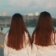 Beautiful Young Twins Girls of European Appearance on a Walk in the City in the Summer at Sunset - VideoHive Item for Sale