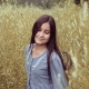 Portrait. A Beautiful Little Girl Is Walking on a Field in Tall Grass and Smiling with Happiness - VideoHive Item for Sale