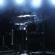 Professional Drum Set with Chair. Black Smoky Background. Back Light. Side View