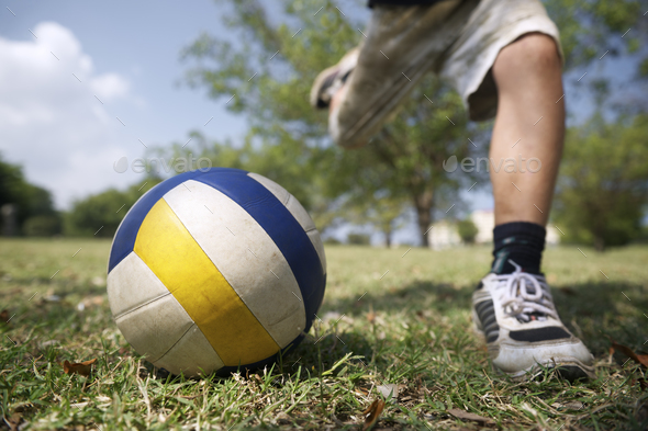 Kids Playing Soccer Game Young Boy Hitting Ball In Park - Stock Photo - Images