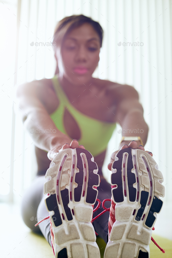 Home Fitness Black Woman Doing Legs Stretching On Pad - Stock Photo - Images