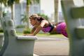 Woman Training Pectorals Doing Pushups On Street Bench