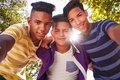Multiethnic Group Of Teenagers Embracing Smiling At Camera - PhotoDune Item for Sale