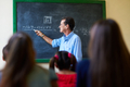 Middle Aged Teacher During Math Class At High School