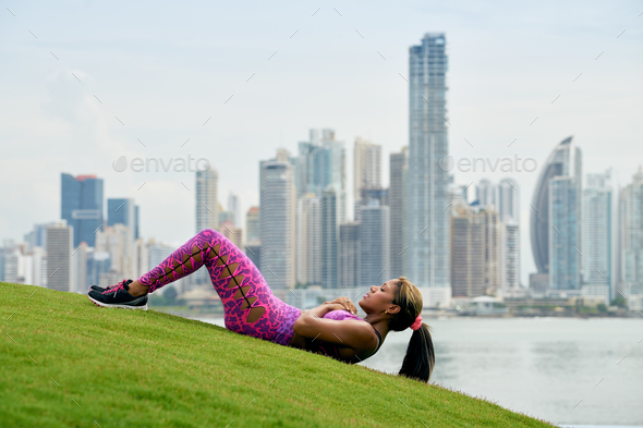Woman Training ABS And Working Out In City Park - Stock Photo - Images