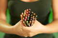 Young Female Painter Holding Colored Pencils At Camera - PhotoDune Item for Sale