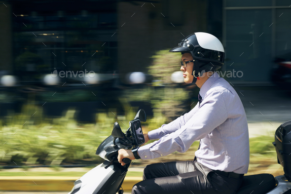 Chinese Businessman Commuter Riding Scooter Motorcycle In City - Stock Photo - Images